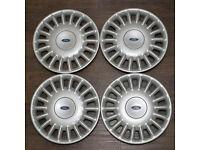 Set of 4 genuine Ford wheel trims - unused