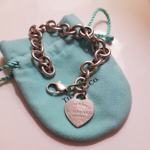 Please return to Tiffany & Co Charm Bracelet