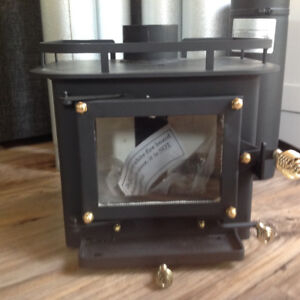 SMALL WOOD STOVE with all FUEL PIPES and PARTS includes.