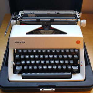 Olympia SM DeLuxe Portable Typewriter