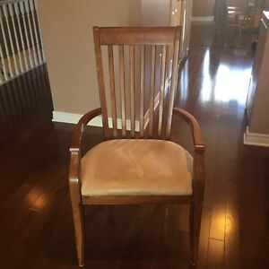 Two oak dining room chairs