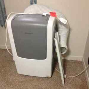 Portable Frigidare AC with dehumidifier and heater.