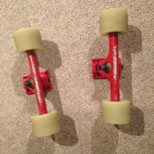 BRAND NEW These Wheels with Caliber 50 degree longboard Trucks