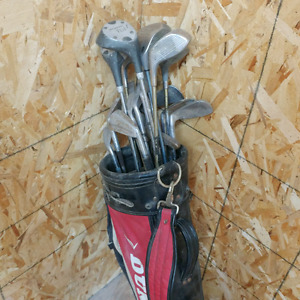 Used golf sticks with bag .