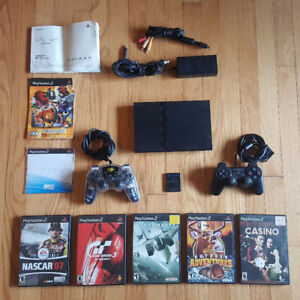 PlayStation 2 Slim, dual controller with 5 games and memory card