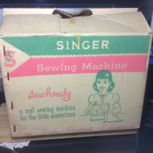 "ANTIQUE TIN TOY ""SINGER"" SEWING MACHINE."