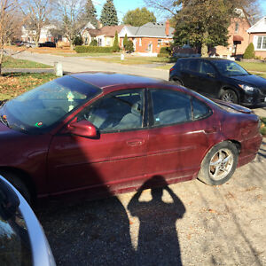 2002 Pontiac Grand Prix, only 170000km, runs fine, Sold as is.