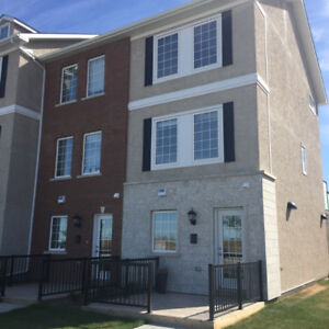 Exclusive Three Story Town Home Condominium In Desirable Sage Cr