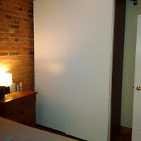 Ikea Pax Wardrobe - brown with white sliding doors