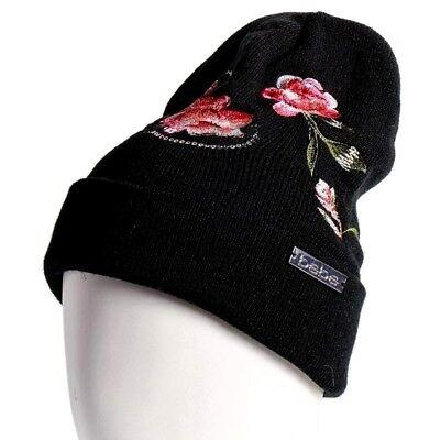 218763ed74b BEBE Women s Sequin Embroidered Floral Knit Logo Beanie Winter Hat Pom Pom  Black