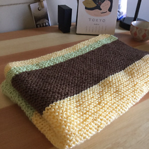 Soft hand-knit baby blanket, perfect shower gift