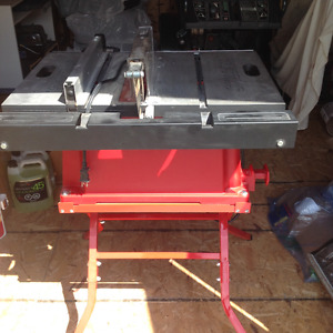 Table saw with fixed stand