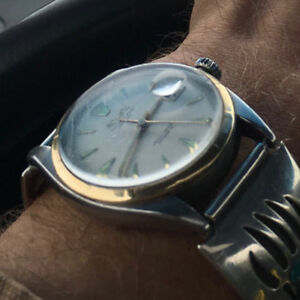"""Heirloom Rolex with """"NORMAN SIMMONS 1956"""" inscribed on back."""