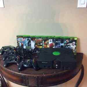 Like New Xbox gaming system, 4 controllers and 10 games!