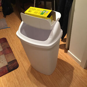 large garbage (70L) bin and left over bags