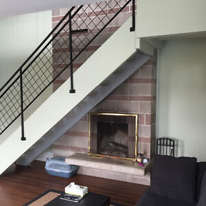 LOCATION!!  2 level 2 Br or 1 Br +den. 16 foot stone fireplace
