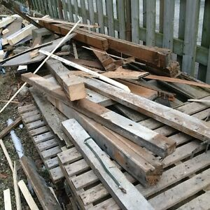 Scrap lumber some old rough cut 2x4's, 2x6's skids for firewood