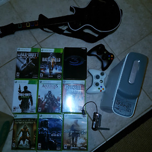 Xbox 360 with two controllers and 9 games