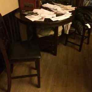 High seating pub table and four chairs