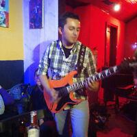 Guitariste cherche bande.