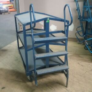 Picking cart with ladder and slanted shelves