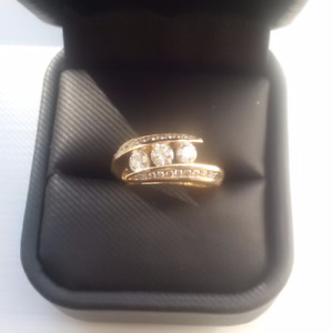 1 carat total weight, 14 k gold ring with 3 x .20 stones plus..
