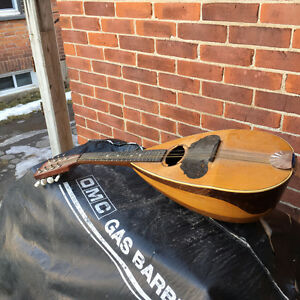 antique mandolin doesn't play just a decoration or needs repairs