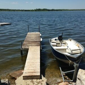 Waterfront with Boat and Motor on Lake Dalrymple near Orillia