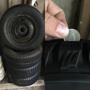 Winter tires 215\65\15 a year old only 1000 kolometers Cambridge Kitchener Area image 1
