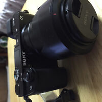 Sony A6000 w/ kit lens + zeiss 24mm 1.8 + extras