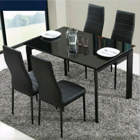 Dining table and 4 chairs new in box