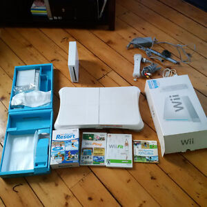 Wii System in box with 4 games and wii fit and board