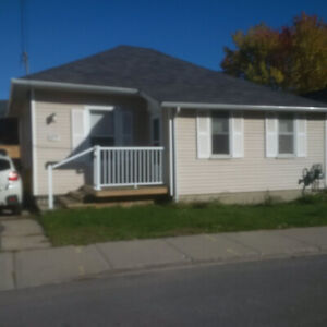 Close in 2br + den bungalow for sublet