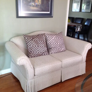 Immaculate two love seats and wind back recliner