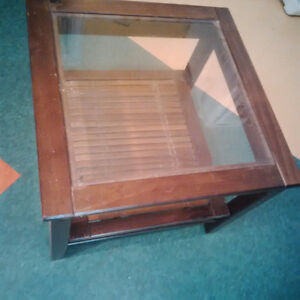 Small glass top end table $25
