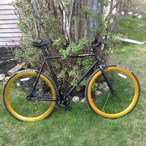 Stolen Purefix black and gold bike