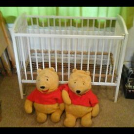 Wooden cot (with the option of puchasing 'Winnie The Poo' toys).