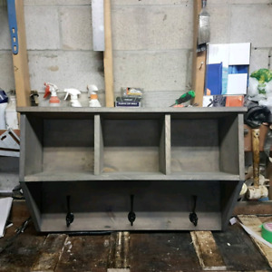 Custom built cost hanger with storage cubbies