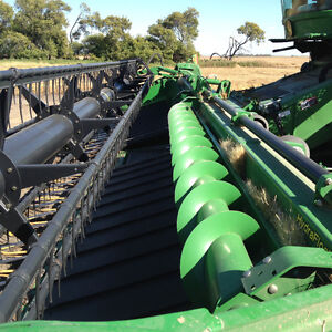 JD Header equipped to straight cut canola etc.