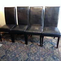 set of four leather chairs