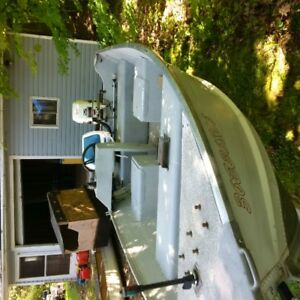 13ft Lowe Deep hull Fishing boat with a 25 hp Johnson, console