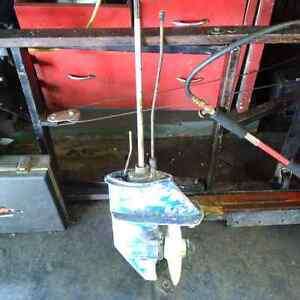 9.9 suzuki outboard    blue color  lower unit and prop