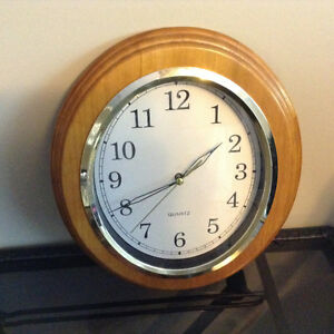 Oval wooden wall clock works perfect