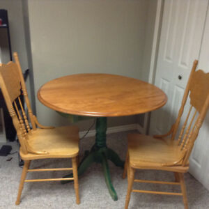 EXCELLENT CONDTION TABLE AND CHAIRS. RARELY USED