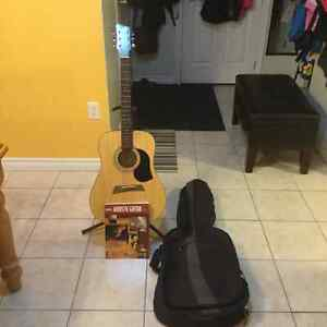 Acoustic guitar with beginners book and case