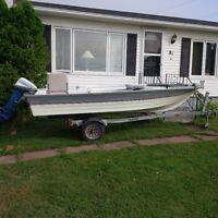 9.9 Evenrude motor and 15ft fiberglass boat for sale
