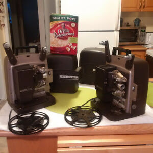 2  IDENTICAL VINTAGE Bell & Howell  Film Projectors