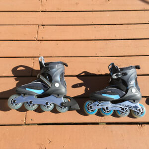 WOMAN'S ROLLER BLADES—IN-LINE SKATES