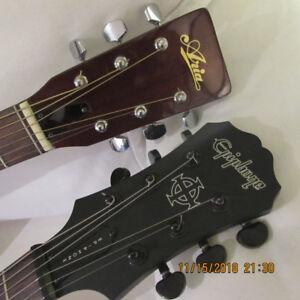 (2) deux guitares à vendre avec étuis  __  350$ __ les deux.