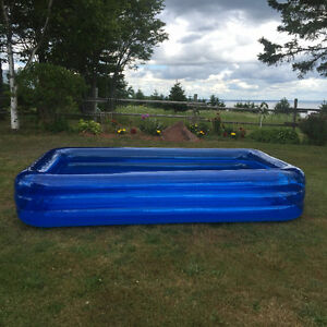 child's swimming pool with an air pump